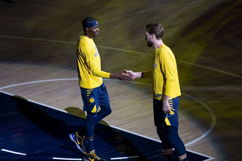 Justin Holiday (L) and Domantas Sabonis (R) of the Indiana Pacers